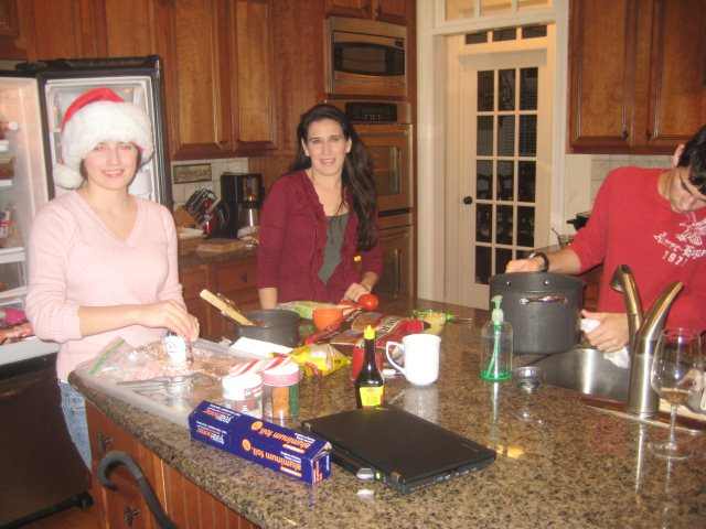 Lorena, Kelly, and Christian make chocolate pretzels for meeting