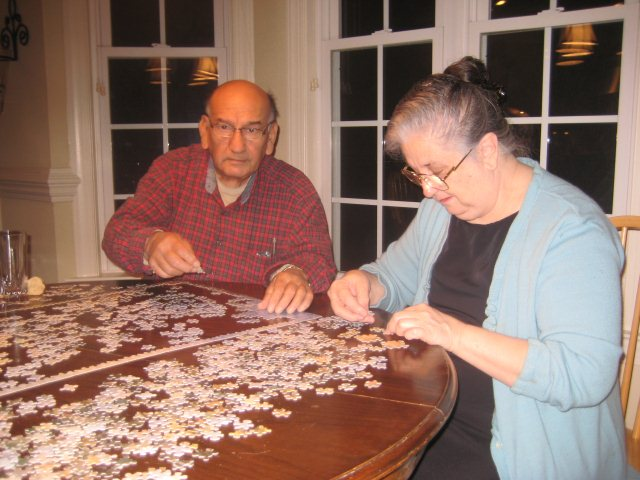 Grandpa Lauro and Grandma Conchita put together the puzzle
