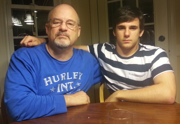 A serious 18th Birthday picture of Christian with Dad