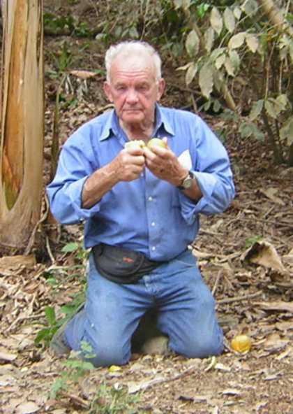 Grandp Milo eating oranges in Ecuador
