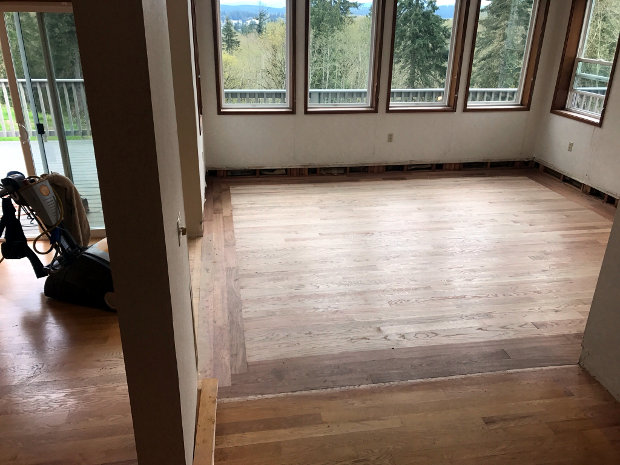 Unfinished hardwood floor in living room #1