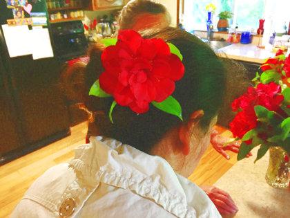 Bonnie puts a flower in Lorena's hair