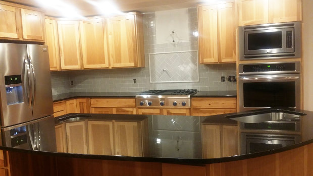 Almost done: View of the stove, ovens and backsplash