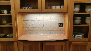 Coffee shelf with backsplash tile in place, but no grout