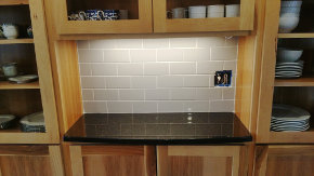 Coffee shelf with backsplash tile in place and grout