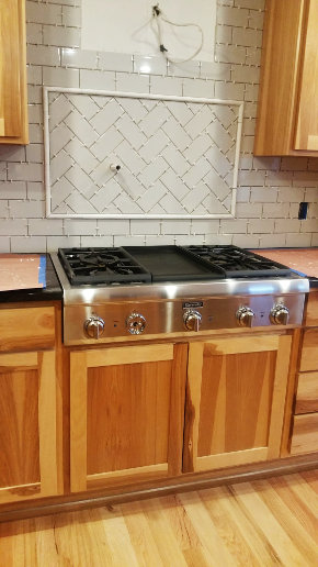 Stove top backsplash, no grout, stainless knobs