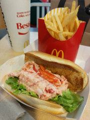 Christian eats a lobster roll at the Park Street McDonald's in Boston