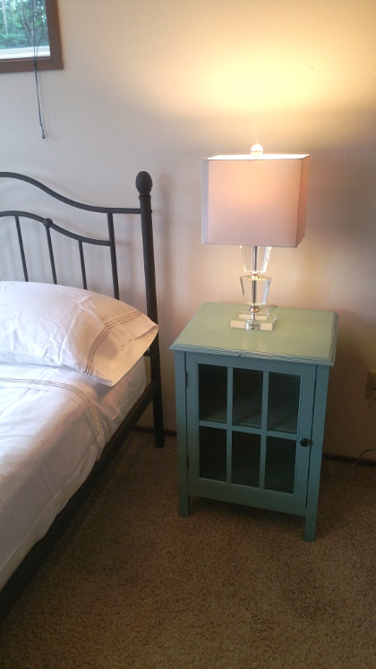 Green Goodwill nightstand with a ding