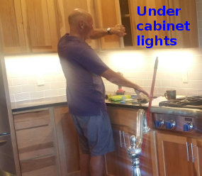 Mark installs the under cabinet lights