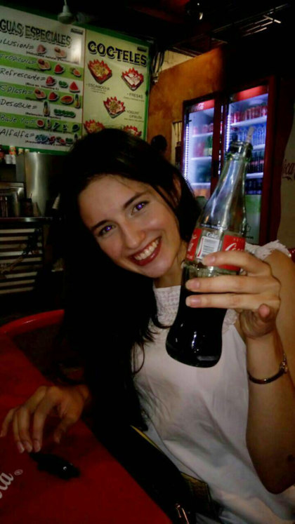 Kelly eats tacos and drinks Coca Cola at a hole in the wall in Monterrey